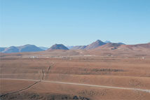 Figure 2. The view toward the array center from Cerro Chico.  The Technical Buildings are to the left; the Cosmic Background Imager facility is to the right.  Photo by A. Beelen.