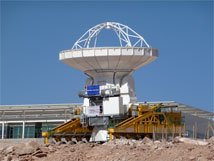 Figure 1. Antenna transporter Lore moves a Vertex antenna past the OSF Technical Buildings to a testing site.