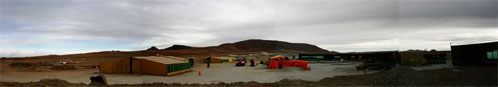 Figure 2:  A panorama of construction at the Atacama Compact Array (ACA) site.  Concrete poured for foundations must be cured at a controlled temperature inside tented structures (center).  The ACA has 22 foundations and will be used for initial astronomical validation.
