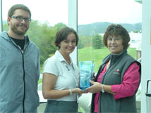The Mountain State Award is presented to Cara Rose and Bill Saxton on behalf of the NRAO by Gail Hyer, Marketing Specialist for the Pocahontas County Convention and Visitors Bureau.