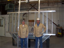 This photo shows Tommy Montoya and Adrian Zamora of the VLA Weld Shop with the last EVLA feed cone floor, #28
