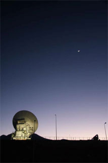 Figure 1: The first ALMA production antenna validates the ALMA system through observations of the Moon.